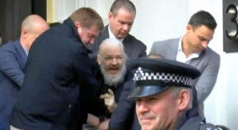 Assange used embassy as center for spying: Ecuador